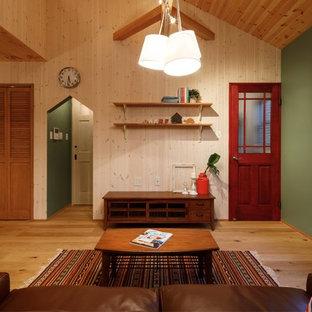 他の地域の北欧スタイルのおしゃれなLDK (マルチカラーの壁、無垢フローリング、茶色い床) の写真