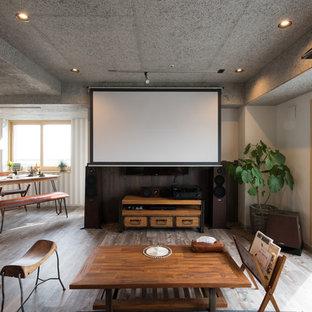 札幌のアジアンスタイルのおしゃれなLDK (フォーマル、グレーの壁、無垢フローリング、茶色い床) の写真