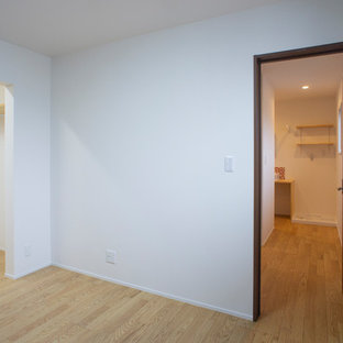 Example of an asian closet design in Other