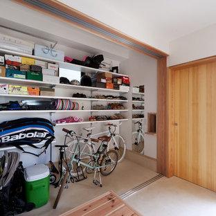 Idee per armadi e cabine armadio minimal con pavimento in cemento