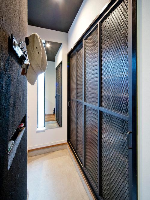Foto e idee per armadi e cabine armadio armadi e cabine armadio industriali con ante in legno - Foto di cabine armadio ...