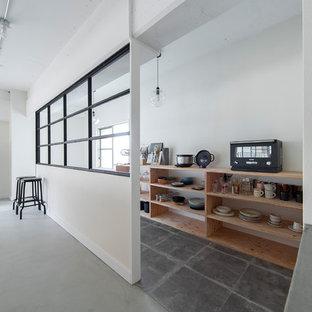 Large industrial walk-in wardrobe in Osaka with grey floor.