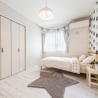 東京23区の北欧スタイルのおしゃれな子供部屋 (マルチカラーの壁、淡色無垢フローリング、児童向け) の写真