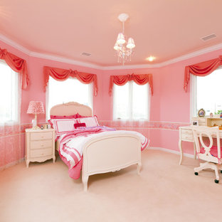 Inspiration for a victorian kids' bedroom for girls in Other with pink walls, carpet and beige floor.
