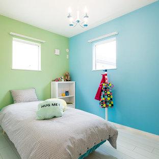 東京都下のコンテンポラリースタイルのおしゃれな子供部屋 (塗装フローリング、ベージュの床、青い壁) の写真