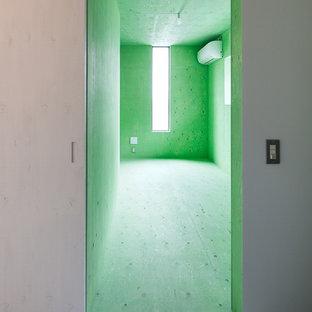 Immagine di una cameretta per bambini con pareti verdi e pavimento verde