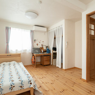 Kids' room - shabby-chic style light wood floor and multicolored floor kids' room idea in Other with white walls