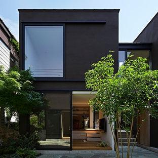 東京23区のコンテンポラリースタイルのおしゃれな家の外観 (茶色い外壁) の写真