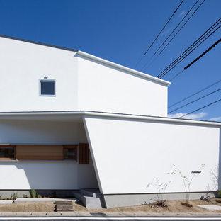 名古屋の中くらいのモダンスタイルのおしゃれな家の外観 (漆喰サイディング) の写真