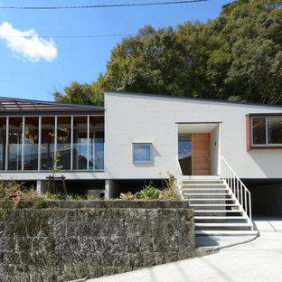 他の地域, のモダンスタイルのおしゃれな家の外観 (コンクリートサイディング、片流れ屋根、戸建) の写真