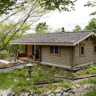 ラスティックスタイルのおしゃれな平屋 (木材サイディング、グレーの外壁、切妻屋根、戸建) の写真