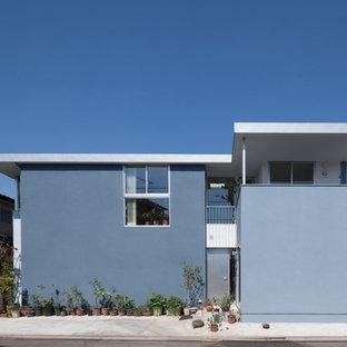 東京23区のコンテンポラリースタイルのおしゃれな陸屋根 (青い外壁) の写真