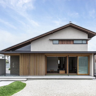 Inspiration for an asian gray two-story mixed siding exterior home remodel in Other