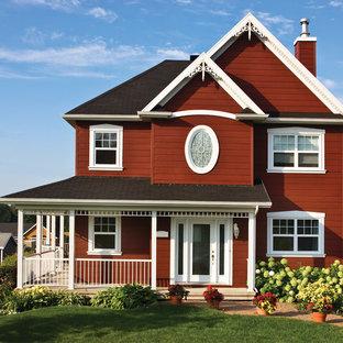 他の地域のトラディショナルスタイルのおしゃれな家の外観 (ベージュの外壁) の写真