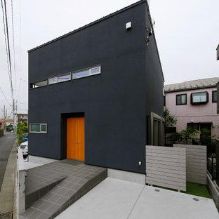 東京23区の中くらいのインダストリアルスタイルのおしゃれな家の外観 (混合材サイディング、グレーの外壁) の写真