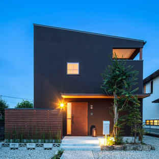 Photo of a black modern two floor exterior in Other with a lean-to roof.