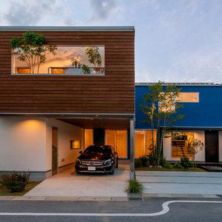 他の地域のモダンスタイルのおしゃれな家の外観 (青い外壁) の写真