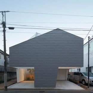 東京23区のコンテンポラリースタイルのおしゃれな家の外観 (グレーの外壁) の写真