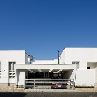 他の地域のモダンスタイルのおしゃれな白い家 (陸屋根) の写真