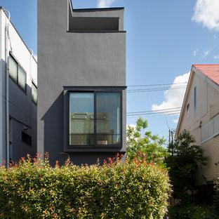 東京23区のモダンスタイルのおしゃれなグレーの家の写真