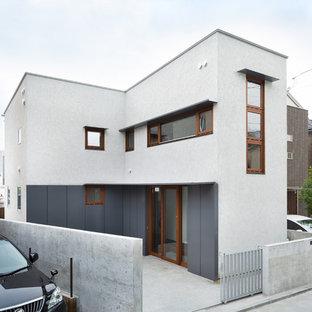 横浜の中くらいのコンテンポラリースタイルのおしゃれな家の外観 (漆喰サイディング) の写真