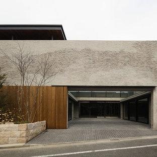 東京23区のモダンスタイルのおしゃれな二階建ての家 (グレーの外壁、陸屋根、戸建) の写真