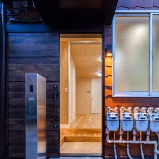Inspiration pour une façade de maison orange nordique de taille moyenne, à un étage et en briques peintes avec un toit à deux pans et un toit en shingle.