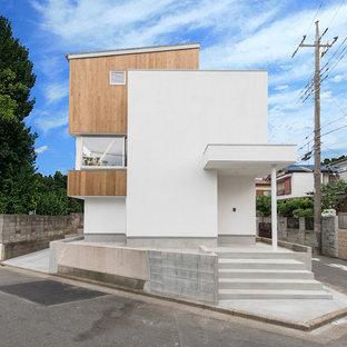 東京都下のモダンスタイルのおしゃれな家の外観 (混合材サイディング) の写真