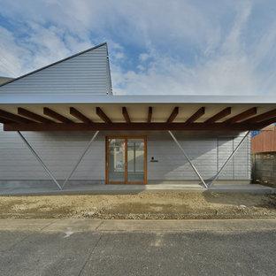 名古屋のコンテンポラリースタイルのおしゃれな家の外観 (グレーの外壁、戸建) の写真
