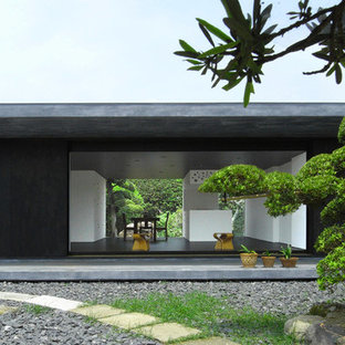 Black one-story wood flat roof photo in Other