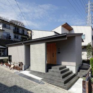他の地域のモダンスタイルのおしゃれな一戸建ての家 (グレーの外壁) の写真