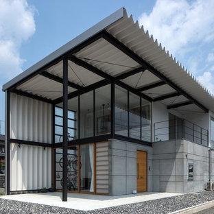 他の地域のコンテンポラリースタイルのおしゃれな家の外観 (石材サイディング) の写真