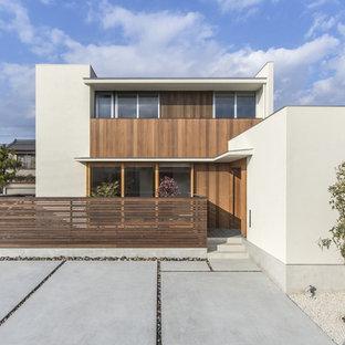 Idéer för mellanstora orientaliska vita hus, med två våningar, blandad fasad och platt tak