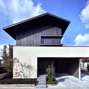 福岡の中くらいのアジアンスタイルのおしゃれな家の外観 (木材サイディング) の写真