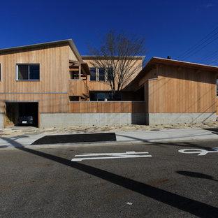 名古屋の中くらいの北欧スタイルのおしゃれな家の外観 (木材サイディング) の写真