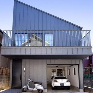 他の地域のコンテンポラリースタイルのおしゃれな家の外観 (メタルサイディング、グレーの外壁、片流れ屋根、戸建、金属屋根) の写真