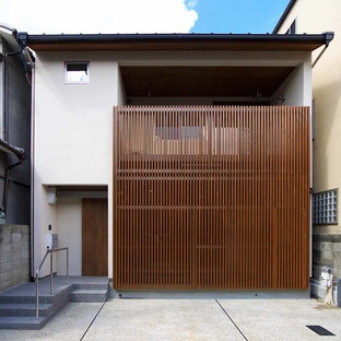Zen white two-story mixed siding flat roof idea in Kyoto