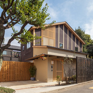 Mid-sized brown two-story stucco exterior home photo in Tokyo Suburbs with a metal roof