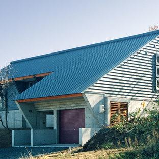 他の地域のコンテンポラリースタイルのおしゃれな陸屋根の家 (コンクリートサイディング、グレーの外壁) の写真