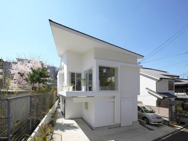 コンテンポラリー 家の外観 by UME architects