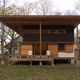 Zen brown wood house exterior idea in Other