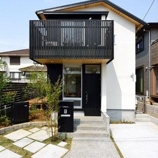 横浜の中くらいのコンテンポラリースタイルのおしゃれな家の外観 (木材サイディング) の写真
