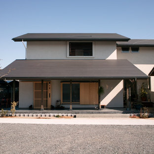 Inspiration for an asian beige two-story mixed siding gable roof remodel in Other