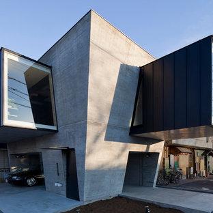 モダンスタイルのおしゃれな家の外観 (コンクリートサイディング、グレーの外壁) の写真