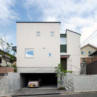 他の地域, のトラディショナルスタイルのおしゃれな家の外観の写真