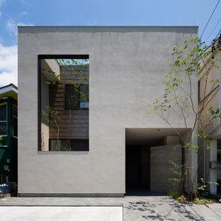 他の地域のコンテンポラリースタイルのおしゃれな家の外観 (コンクリートサイディング、グレーの外壁) の写真