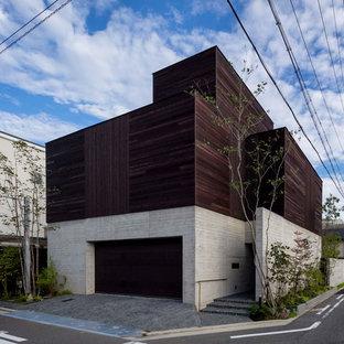 大阪のモダンスタイルのおしゃれな四角い家 (マルチカラーの外壁) の写真