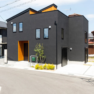 Industrial black split-level metal house exterior idea in Other with a shed roof and a metal roof