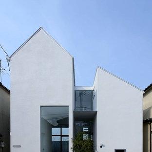 他の地域のコンテンポラリースタイルのおしゃれな家の外観 (コンクリートサイディング) の写真