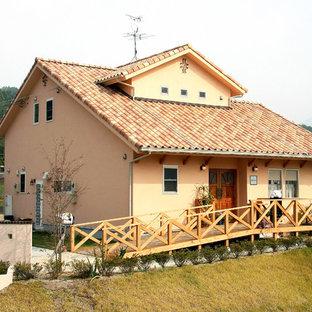 他の地域の地中海スタイルのおしゃれな家の外観 (オレンジの外壁) の写真